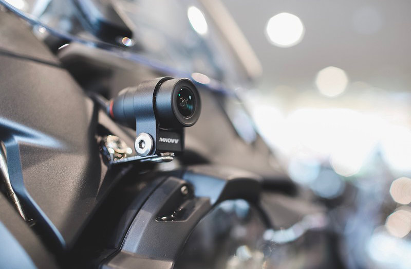 Picture of a camera mounted to the front of a motorcycle